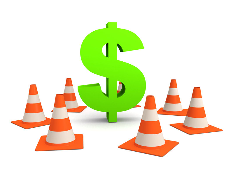 dollar sign and traffic cones